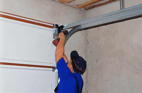 WHAT IS THE RECOMMENDED MAINTENANCE FOR A GARAGE DOOR?